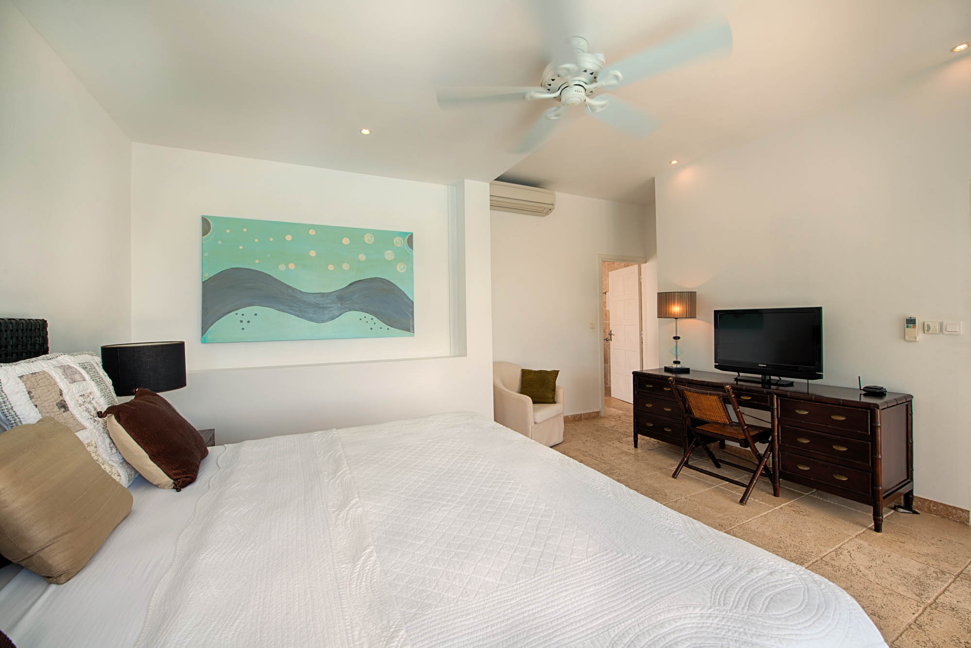 Each of the large bedrooms of this Caribbean luxury villa has a king sized bed.