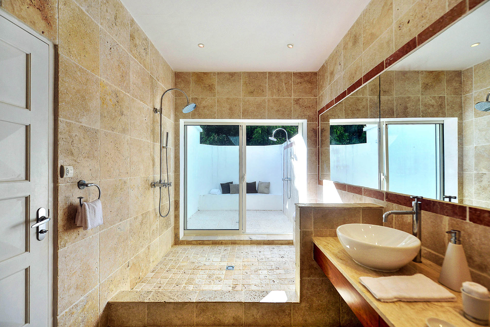The guest bedroom offers an enclosed shower out.