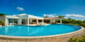 The swimming pool of Lune de Miel, Baie Longue, Terres-Basses, is exceptionally large for a two bedroom villa.