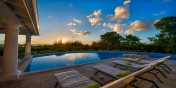 Fall in love with the gorgeous sunset views at this Terres-Basses vacation villa rental.