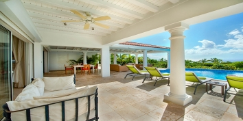 Comfortable, contemporary furnishings for outdoor Caribbean living at this Terres-Basses vacation villa rental.