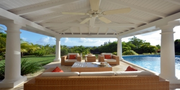 Relax beside the pool inside the cozy lounges under the shaded deck of Lune de Miel villa rental, Baie Longue, Terres-Basses, Saint Martin, Caribbean.