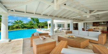 The shaded pool deck of Lune de Miel, Baie Longue, Terres Basses, St. Martin villa rental, French West Indies.