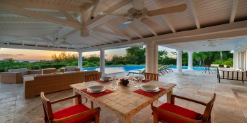 The spacious pool deck with beautiful sunset views in the background, Lune de Miel villa rental, Baie Longue, Terres-Basses, Saint Martin, Caribbean.