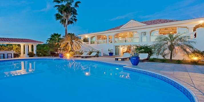 A beautiful 5 bedroom, 5 bathroom, hillside villa with huge pool, poolside bar, a dining and sitting gazebo to enjoy the magnificent Caribbean views!