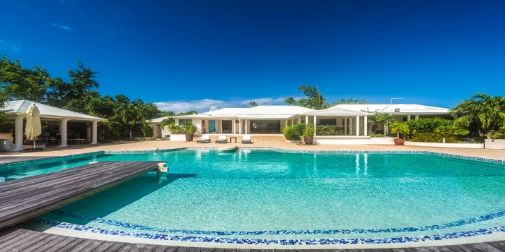 A magnificent, fully air conditioned villa, with three bedrooms, swimming pool, modern interior, and gazebo with stunning views of Simpson Bay!