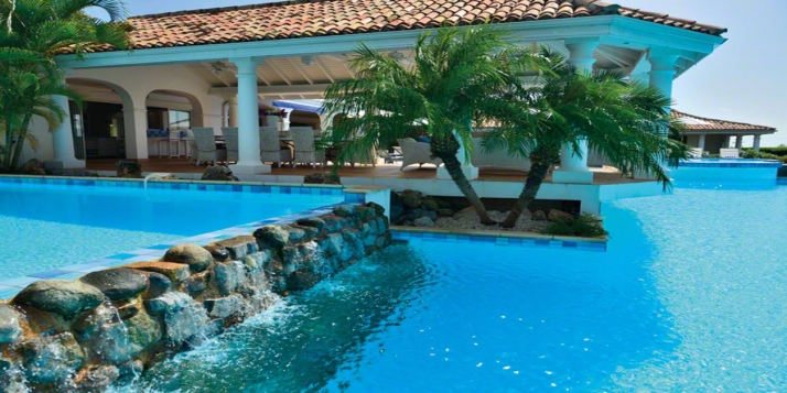 A gorgeous 4 bedroom villa with one of the largest swimming pools on the island and stunning views!