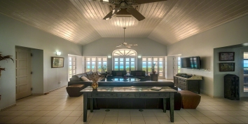 The spacious living room of villa Eden, Long Bay Beach, Terres Basses, St. Martin, French West Indies.