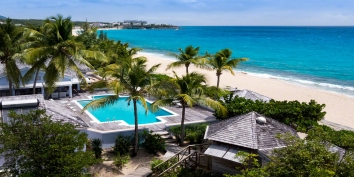 A gorgeous Caribbean beachfront villa with 5 bedrooms, large heated swimming pool and gorgeous sea views!