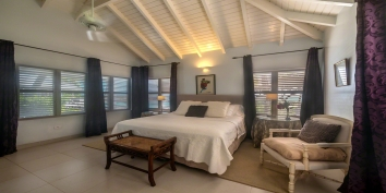 A spacious bedroom at villa Eden, Long Bay Beach, Terres Basses, St. Martin villa rental, French West Indies.