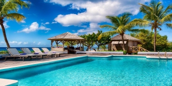 Eden villa rental has a large heated swimming pool and sits directly on Long Bay Beach, Saint Martin, Caribbean.