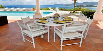Enjoy alfresco dining at this luxury St. Martin villa rental, French West Indies.