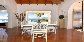 The dining area of Villa Beaulieu, Long Bay Beach, Terres Basses, St. Martin villa rental, French West Indies leads directly to the pool deck.