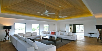 The contemporary, spacious living room of Green Lagoon, Petit Cul de Sac, St. Barts luxury villa rentals, Caribbean.