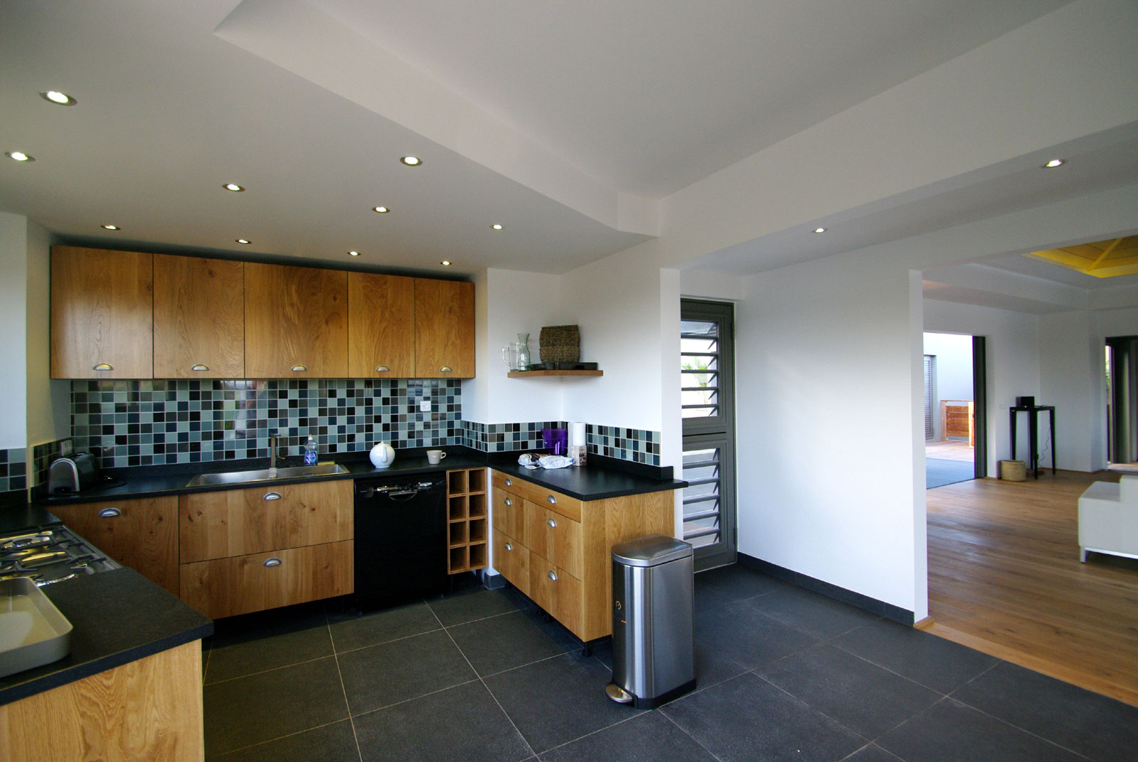 The modern and fully equipped kitchen of this St. Barts luxury villa rental.