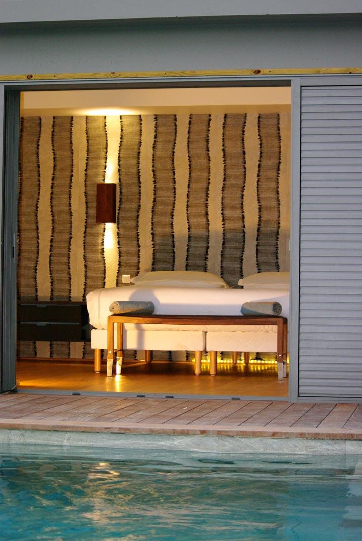 A spacious, modern bedroom at Green Lagoon, St. Barts luxury villa rentals.