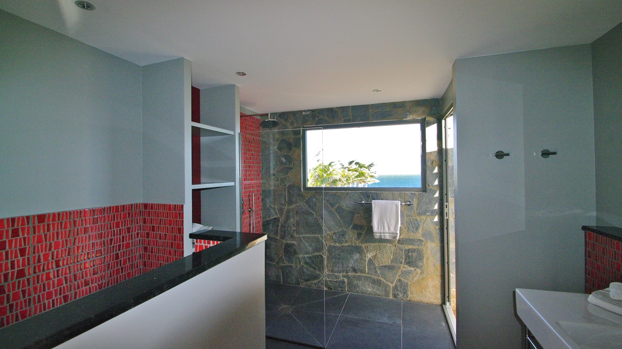 A spacious, modern bathroom with walk-in shower at Green Lagoon  Petit Cul de Sac, St. Barts luxury vacation villas.