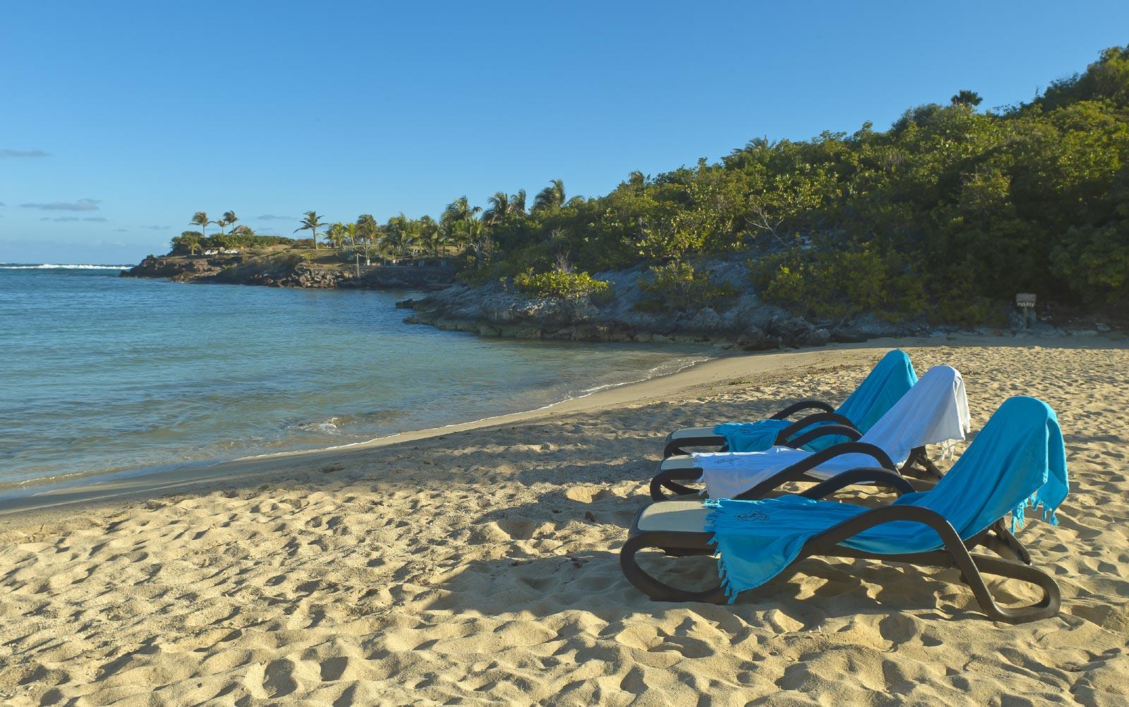 An almost perfect crescent of sandy beach at Petit Cul de Sac, St. Barths, Caribbean.