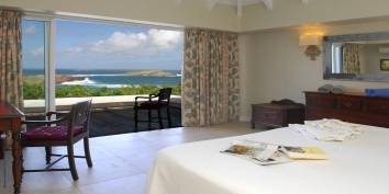 Every bedroom of this St. Barts luxury villa rental opens onto the terrace with stunning lagoon views.