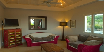 Enjoy TV with cooling ceiling fans during your vacation at Baby Blue, Petit Cul de Sac, St.Barts villa rental.