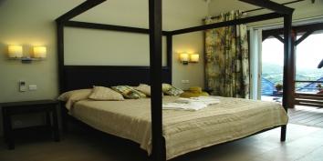 A very comfortable four-poster bed in the spacious bedroom of Lagon Bleu Estate, Petit Cul de Sac, St. Barts luxury villa rentals, Caribbean.