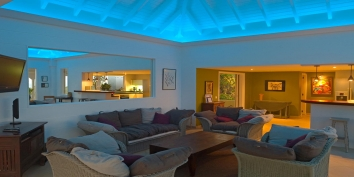 The mood lighting of the living room enhances the feeling of a Blue Lagoon at this St. Barts luxury villa rental, Caribbean.  Blue Lagoon, Levant Estate, Petit Cul de Sac, St. Barts villa rentals.