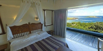 Wake up and overlooking Petit Cul de Sac in the comfortable bedroom of this St. Barths luxury villa rental, Caribbean.