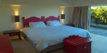 A spacious bedroom with classic furnishings at Villa Blue Lagoon, Levant Estate, Petit Cul de Sac, St. Barts villa rentals.