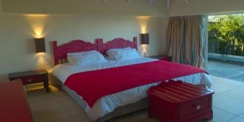 A spacious, classic bedroom at Lagon Bleu, Levant Estate, Petit Cul de Sac, St. Barths villa rentals.