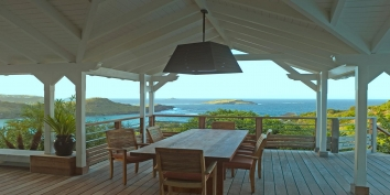 Feel the breezes off the Carribean Sea while dining on your spacious  terrace at Villa Blue Lagoon, St. Barts villa rentals.