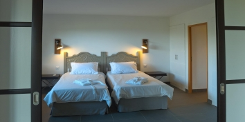 A modern designed bedroom with twin beds, Lagon Jaune, Petit Cul de Sac, St. Barths luxury vacation villas.