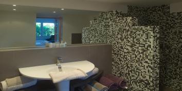 A spacious, modern bathroom at Villa Yellow Lagoon, Petit Cul de Sac, St. Barts luxury villa rentals, Caribbean.