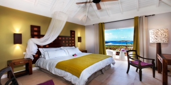 A spacious bedroom suite with luxury Egyptian cotton duvet and duvet cover and wonderful views of the Carribean Sea.