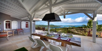 Enjoy outside dining with stunning views of Petit Cul de Sac, while on vacation in this St. Barts luxury vacation villa rental.