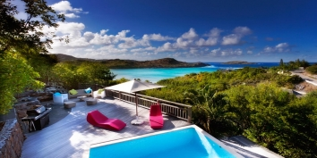 A charming, two bedroom villa with swimming pool and gorgeous views of the shimmering turquoise lagoon.