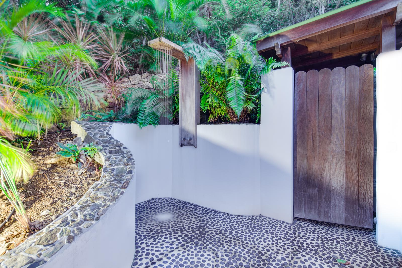 The second bedroom has an additional outdoor shower at Villa Lama, Flamands Heights, Saint-Barthélemy.