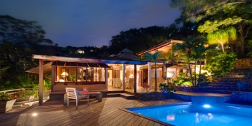 The swimming pool by night at Villa Lama, Flamands Heights, St. Barts, Caribbean.