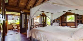 A beautifully decorated bedroom at this St. Barths luxury villa rental.