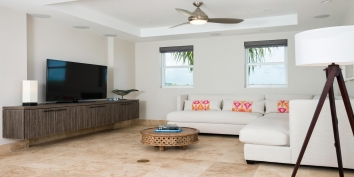 The media room of this luxury villa rental has a 52 flat panel TV