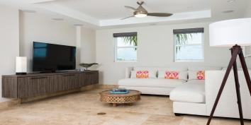 The media room of this luxury villa rental has a 52 flat panel TV
