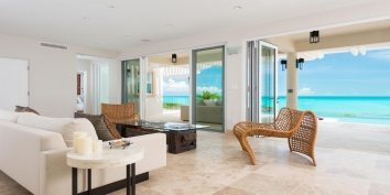 The Great Room of this Turks and Caicos villa rental combines the living, dining, media and kitchen areas