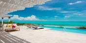 The infinity-edge swimming pool of Villa Isla, Long Bay Beach, Providenciales (Provo), Turks and Caicos Islands