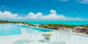 The sun shelf at one end of the swimming pool of this luxury Turks and Caicos holiday villa