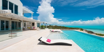 Stylish lounges for soaking up the Caribbean sun at Villa Isla, Long Bay Beach, Providenciales (Provo), Turks and Caicos Islands