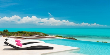 Stylish lounges, infinity pool and stunning views at this Long Bay Beach villa rental
