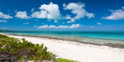 The soft, white, sandy beach right in front of Beach Villa Sandstone, Providenciales (Provo), Turks and Caicos Islands.