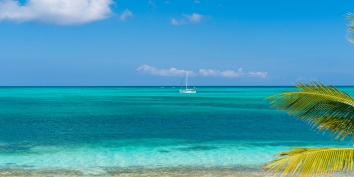 You will see boats small and large while on vacation at Beach Villa Sandstone, Providenciales (Provo), Turks and Caicos Islands.
