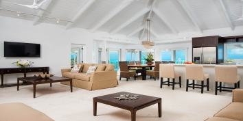 The combined living and dining area at Beach Villa Sandstone, Providenciales (Provo), Turks and Caicos Islands.