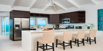 The modern kitchen of this Caribbean villa is fully equipped with everything you may need while on holiday in the Turks and Caicos Islands.