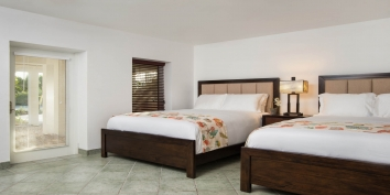 The two beach level bedrooms have two queen-size beds and private en-suite bathrooms.